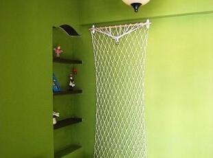 卧室一角安沙发 渔网墙饰夹照片
