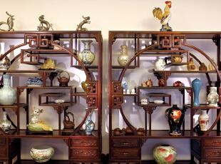 用实木做出结实的框架,以固定支架,中间用棂子雕花,做成古朴的图案。