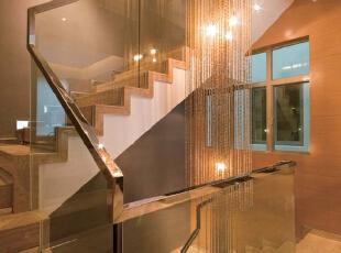 北京别墅装修设计—楼梯间 楼梯间 长的现代水晶吊灯 现代的玻璃扶手 体现出现代气息 简单整洁,300平,38万,现代,别墅,黄色,白色,