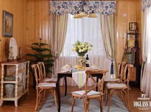 餐厅软装饰的色调和客厅一致,彩绘花架图案的衣帽柜给空间增添了自然气息,温馨而宁静。,220平,70万,现代,别墅,