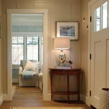 简约形式的玄关设计,最少的家具,最暖的色彩,让人一回家就感受到温馨。